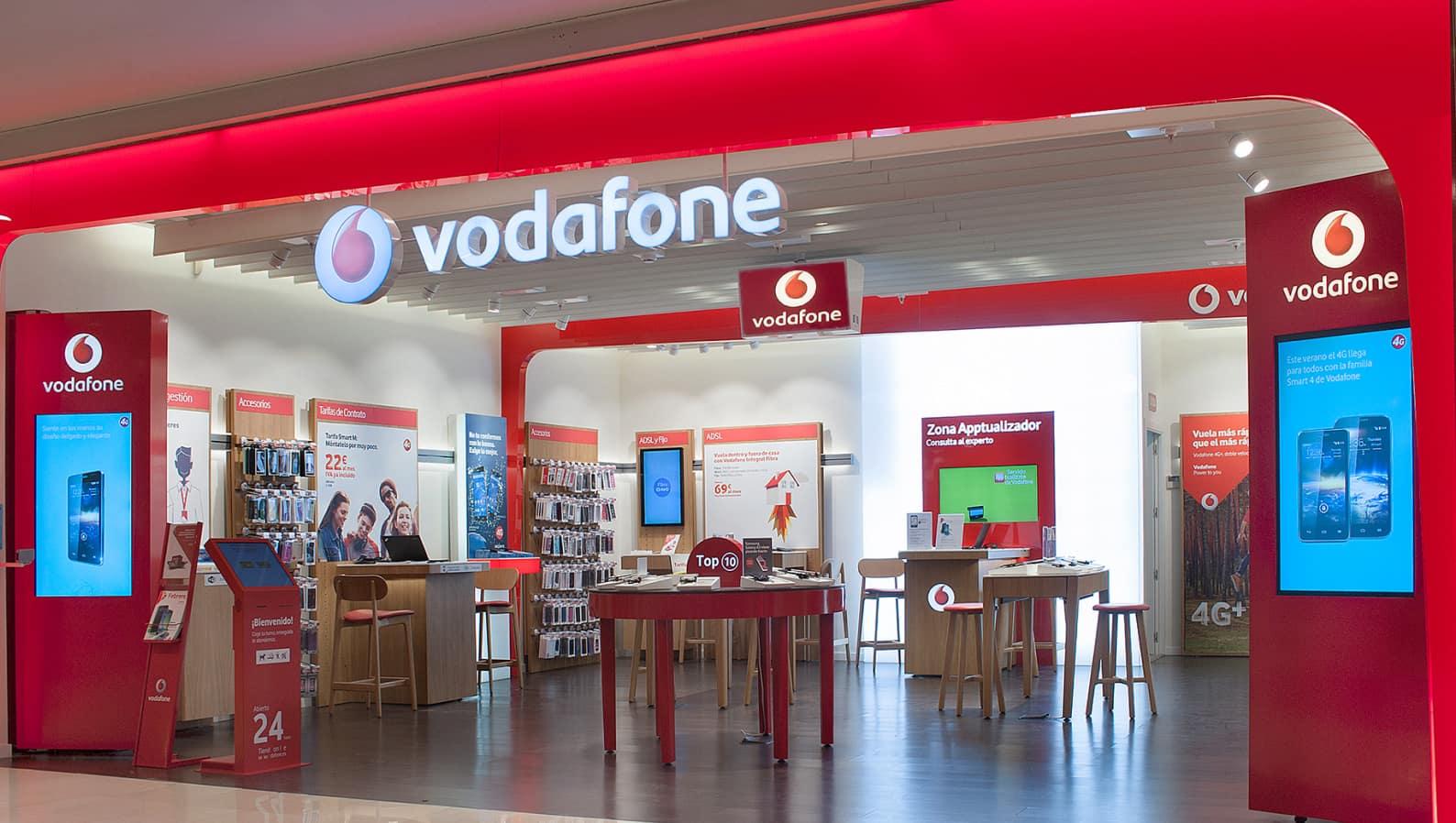 Instalación de rótulo y elementos gráficos en la tienda de Vodafone